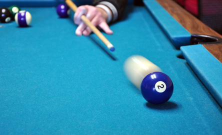 Pool table with cue ball hitting #2.
